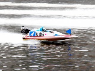 On the straightaway the drivers get low in the boat to keep it from swaying side to side and keep up the fast speed.
