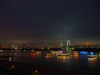 The neon lights reflected on the water create a spectacular sight. Odaiba is the perfect vantage point for watching Tokyo Bay come alive at night.