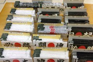 Hachimakior Japanese headbands are a fun souvenir. Slogans likeNumber One, Victory, or Ninja are printed in kanji along with the rising sun motif.