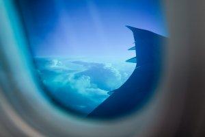 Dimmed views appear cool blue through the cabin windows