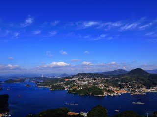 Color of the sky, the East China Sea, and the houses on the hillsides of the Mt. Ishi create exotic scenery