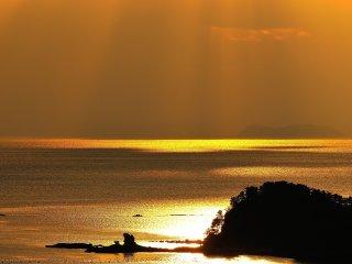 Kujuku-shima Islands radiant in gold at sunset