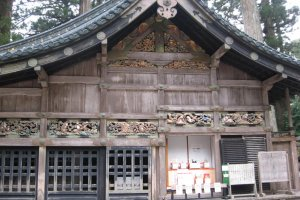 Carvings at Shinkyu,the scared stable, depicting the way of life.