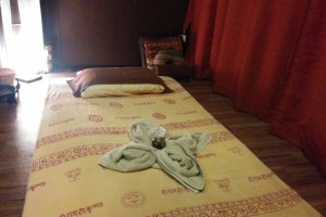 Traditional Thai massages are given in curtained-off private rooms on heated mats