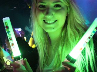 Glow sticks are passed out to the audience members
