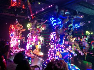 These giant robot female cyborgs make their debut towards the end and have several dancers riding and controlling them