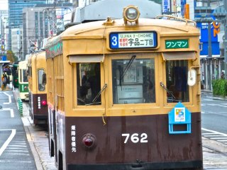 Trams pulling into a station that stops right in front of the dome:Hiroshima's Atomic Bomb Dome