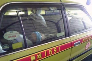 A taxi driver taking a nap in his vehicle - not an uncommon sight.