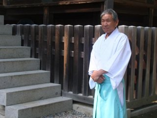 A shinto priest within the grounds of Konpira-san