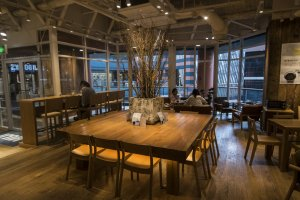 This large table seats 12 customers together here atCafé & Meal MUJI (Canal City Fukuoka).