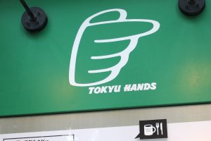 The Tokyu Hands logo and green design