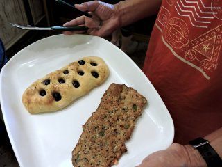 Olive focaccia, and a flat, chewy bread full of sunflower and pumpkin seeds