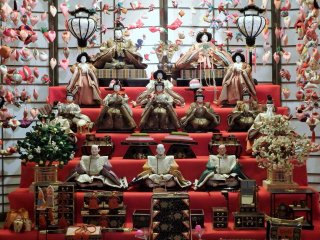 Hundreds of ornament strings and beautiful antique hina dolls are on display.