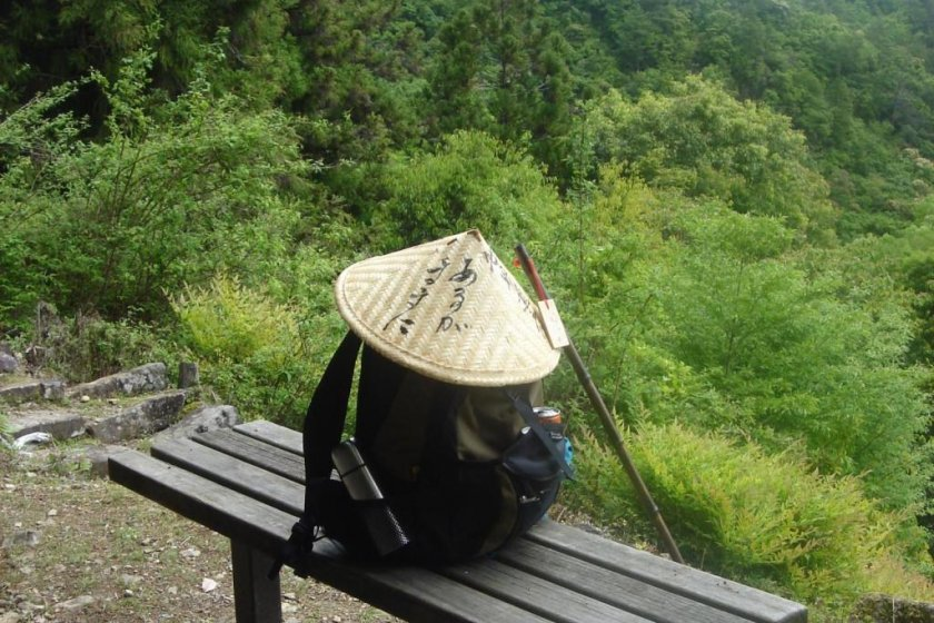 A conic straw hat and a staff are common equipment of pilgrims in Japan