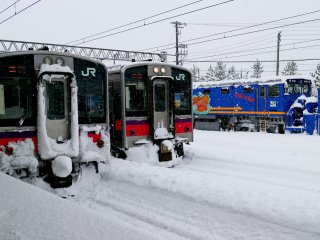 JR trains parked on its platform in Aomori during winter