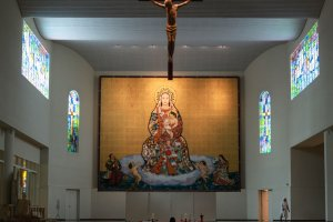 A huge painting of St. Maria Osaka hanging on the church wall