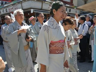 Local community members wearing traditional costumes