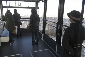 On the way down, passengers move toward the front window for the best view.