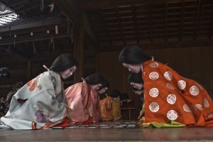 Women dressed in Juni-hitoe play Karuta game