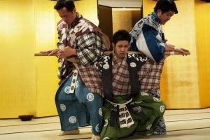 Three actors perform Kyogen