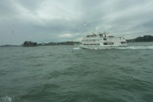Passing another sightseeing boat in Matsushima Bay.