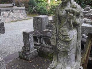 A Buddhist statue around the graveyard