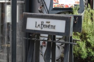 Outdoor sign for Cafe La Boheme