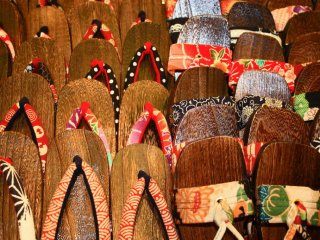 Wooden sandles on sale in Nishiki market - just one of the many traditional souvenirs you can pick up here.