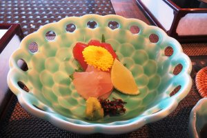 Exquisite Japanese tableware showcasing the sashimi topped with flower
