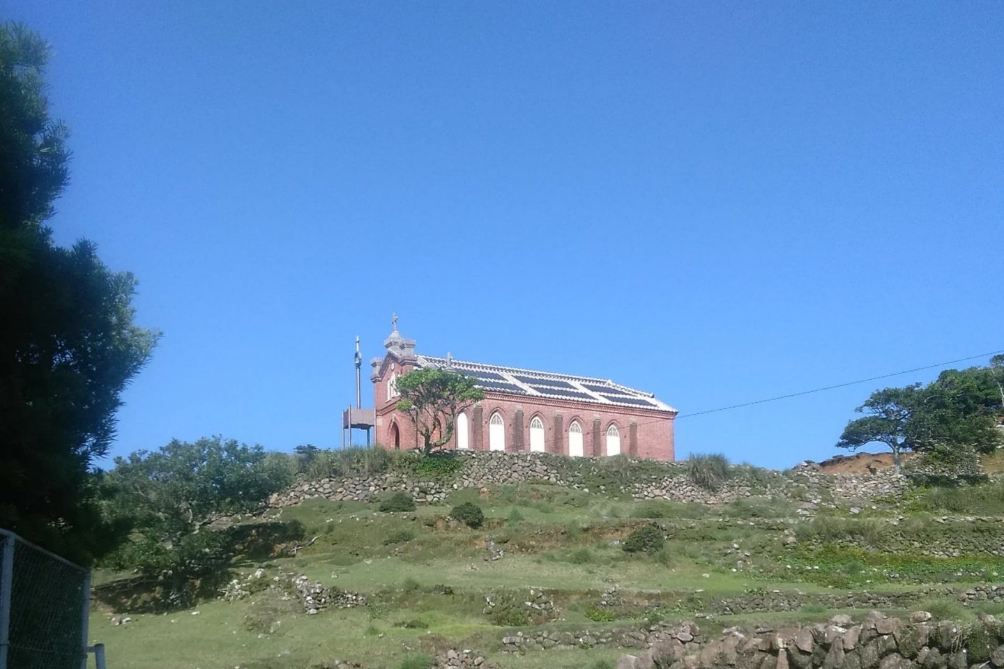Nokubi, the former church from a distance. Notice the roof tile white lines