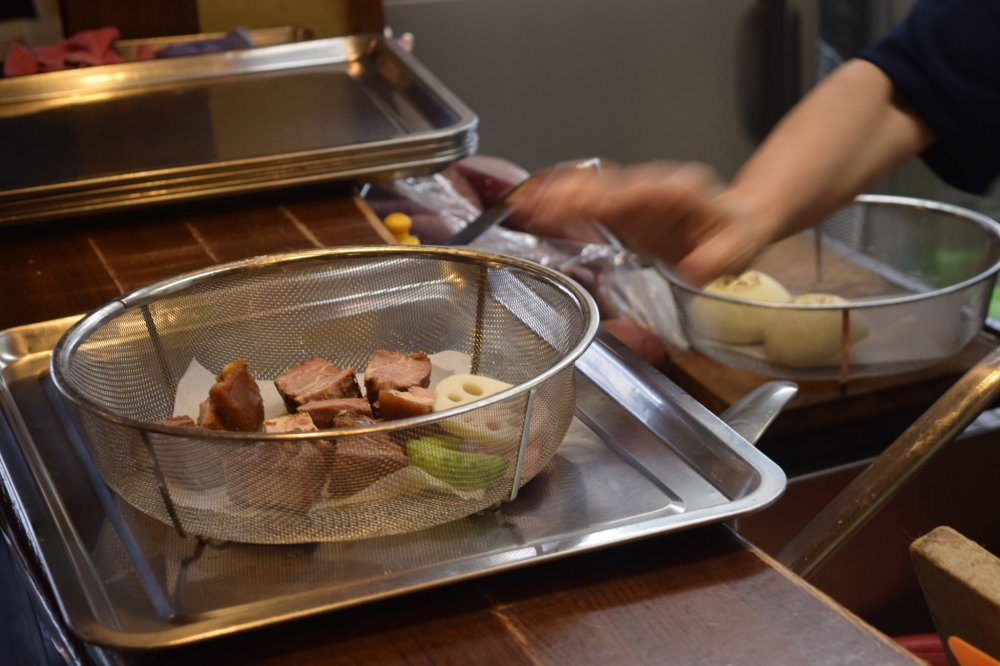 Staff will prepare what you order in wire dishes, ready to place into the steam ovens