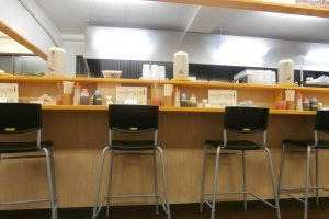 The counter seats with the condiments