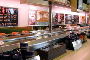 Tables are located along the conveyor belt
