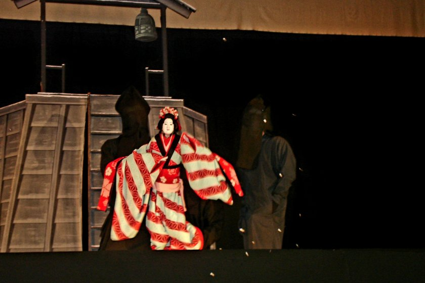 Bunraku puppet in action on stage