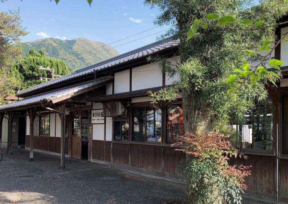 The entrance to Higashi Beppu Station, with Mount Takazaki in the background