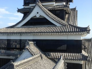 A picture of the larger tower from the smaller one. Notice the fine roofing work that is a 1960s reconstruction implementing authentic tools and materials.