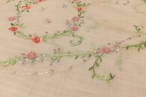 Fabric made in Japan, hand embroidered in Vietnam. Cotton woven to look like linen.
