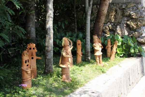 Okinawan art made of Ryukyuan red tile on display along the pathway to the Nakamura House in Kitanakagusuku