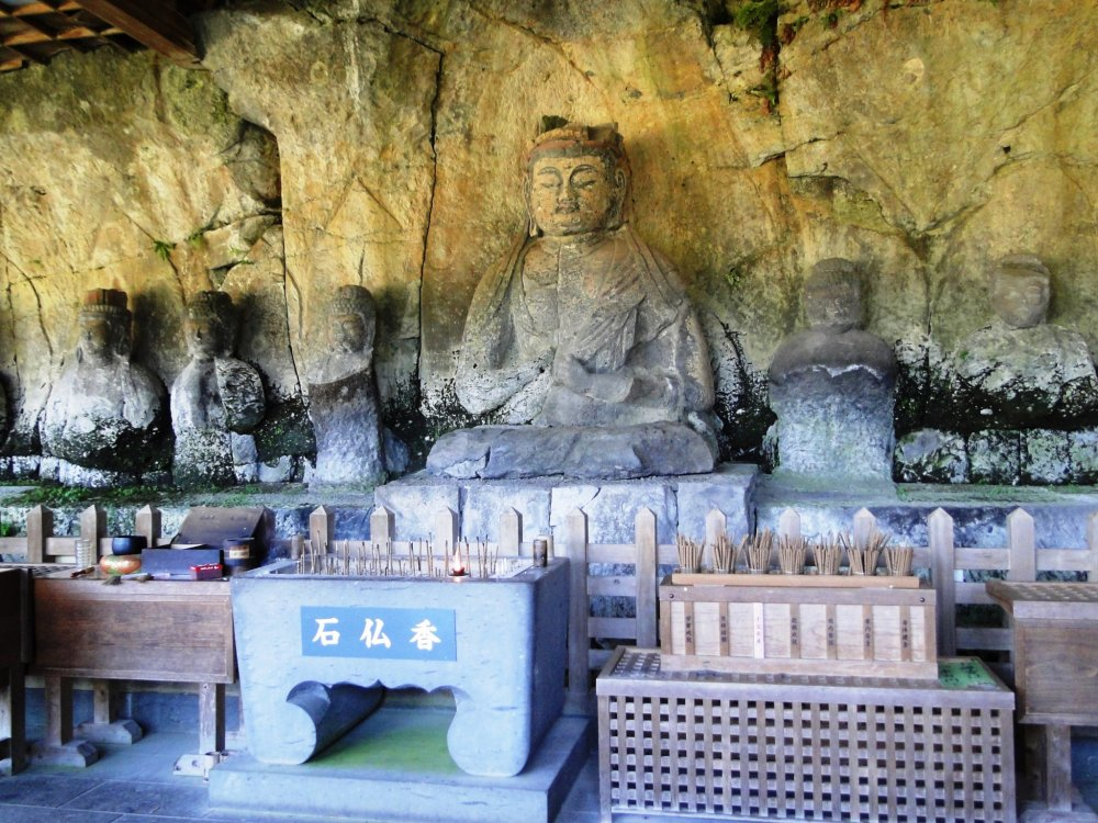 The large buddha's head fell off centuries ago and was only reattached to its body in 1993