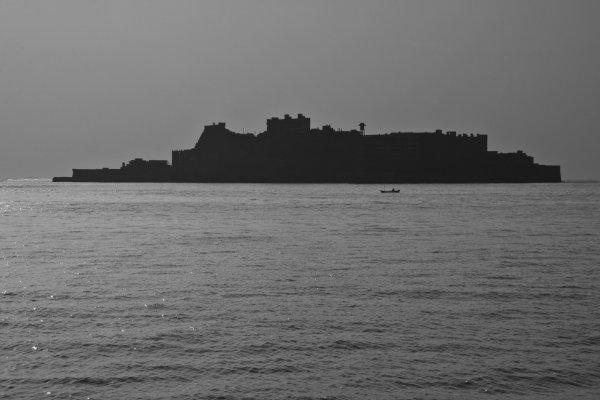 Silhouette of Gunkanjima—it really does look like a battleship.
