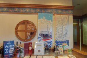By the way, the interior of this restaurant is done up in a ship theme. You might notice two ship tapestries near the entrance. These are the Nippon-Maru and the Hikawa-Maru, ships which are both moored at piers in Yokohama.