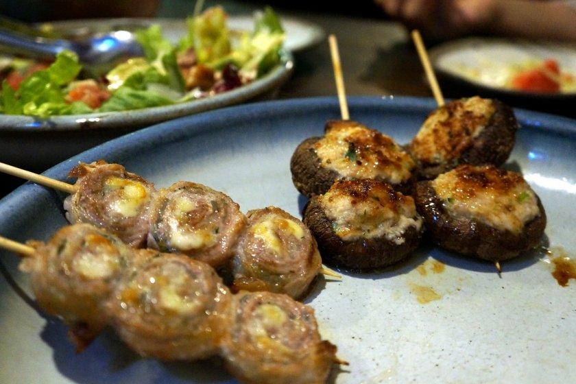 Shiso cheese pork roll and chicken tsukune stuffed shitake mushrooms