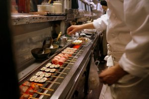 Chef Suzuki at work. An electric grill, he explains, provide much more even heat.