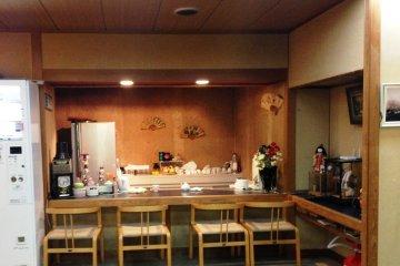 <p>An intimate yet understated sushi bar counter awaits you at Hotel Yoshida</p>