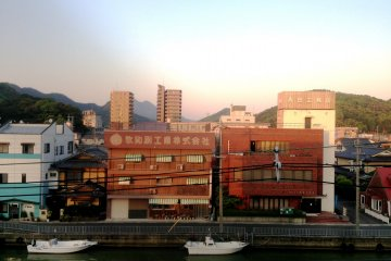 <p>The larger rooms, ending in numbers 1 to 6, have a view of the canal and the distant mountains. This is the view from room 401 at&nbsp;Hotel Yoshida Maizuru</p>