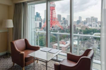 <p>One of my favorite parts of the room was the cushioned chairs and table set right next to the window. Whether you&#39;re reading the newspaper, enjoying a cup of coffee or tea, or just relaxing and enjoying the view, this adds a familiar and cozy dimension to the room.</p>