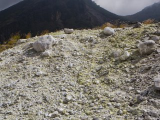 A dark Mt. Karakuni looms high above the peak of Mt. Io