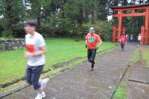 Runners about to finish the Ishidan Marathon