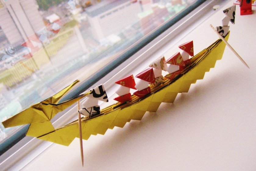 Origami dragon boat complete with tiny passengers