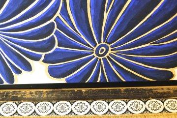 <p>Detail of a lotus painting near the tatami mat floor</p>